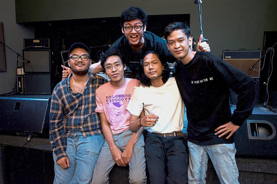 (Middle) Ikram with his Youth Portal bandsmates speaking about their streaming experience, at KL Live Fact where they performed at before the interview.
