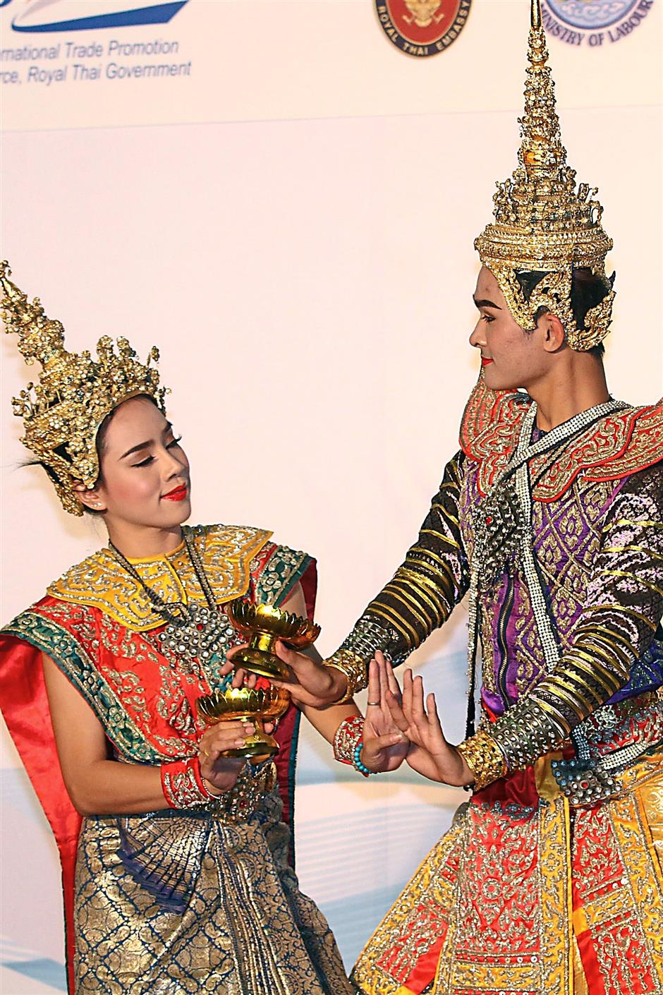 1 Dancers in traditional costumes posing for a group photo after the opening ceremony of the trade fair. 2 Visitors checking out a booth offering instant noodles. 3 The trade fair also features Thai handicrafts 4 Each of the dances featured in Thailand Week 2015 has a unique choreography originating from the different regions of Thailand. — BRIAN MOH / The Star