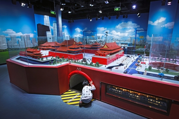 More sites: A child peeps into a tunnel underneath the Forbidden City and Tiananmen Square models at Legoland Discovery Centre in Beijing. Merlin plans another Legoland in South Korea and is looking for sites in China, where it would like to run three by 2030. u2014 AP