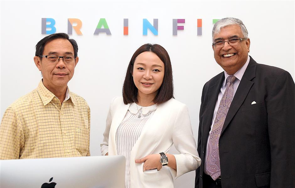 (From left) BrainFit Educare director Lim, managing director Tan and Global Franchise Masters CEO Harish Babla at Malaysias first Brainfit Studio at The Curve.
