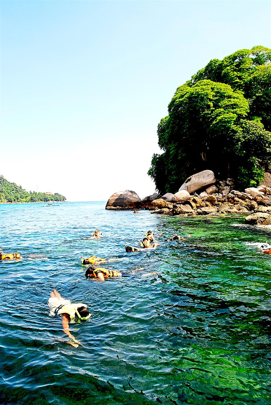 Snorkeling in the pristine waters of Tioman is a thrilling experience.