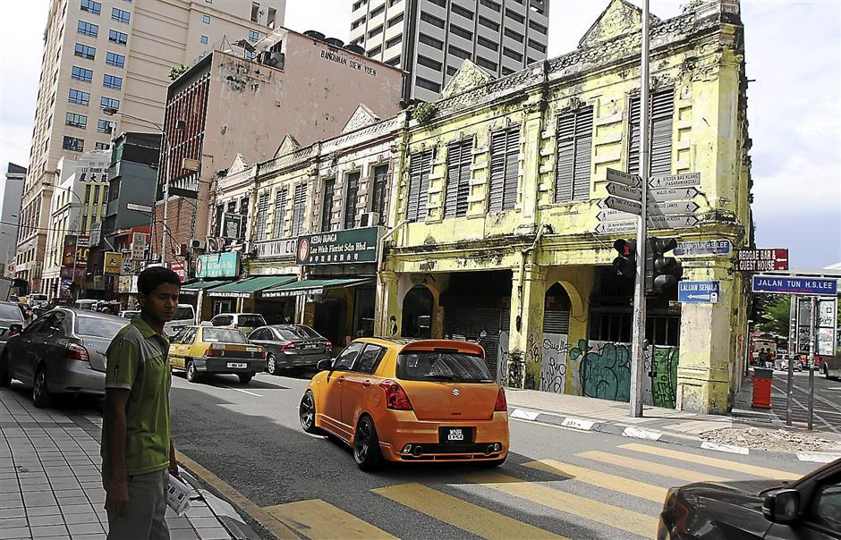 Test of time: There are some 200 old shophouses along Jalan Tun H.S. Lee and their conditions vary - from the better preserved ones now sensitively occupied by cafes to some cast into abandonment.