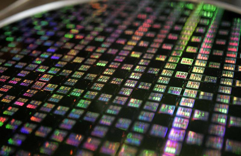 A 12-inch wafer on display at Taiwan Semiconductor Manufacturing Company (TSMC). The company says it posted a net profit in the fourth quarter of NT$44.81bil (US$1.49bil), beating analyst estimates of NT$42bil (US$1.4bil) - Reuters.
