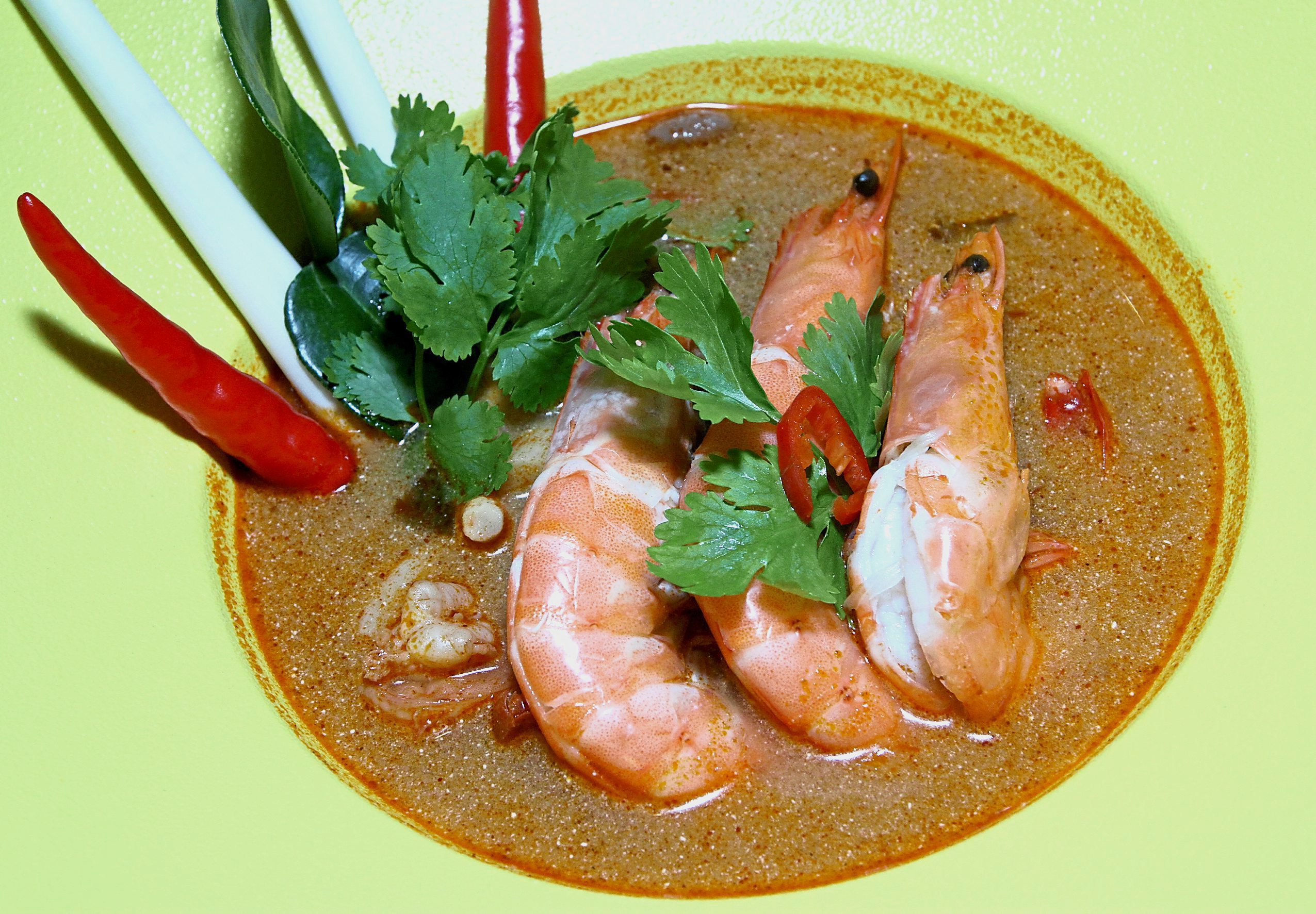 Tom Yum Goong tends to be a little more spicy than the Malaysian  version.