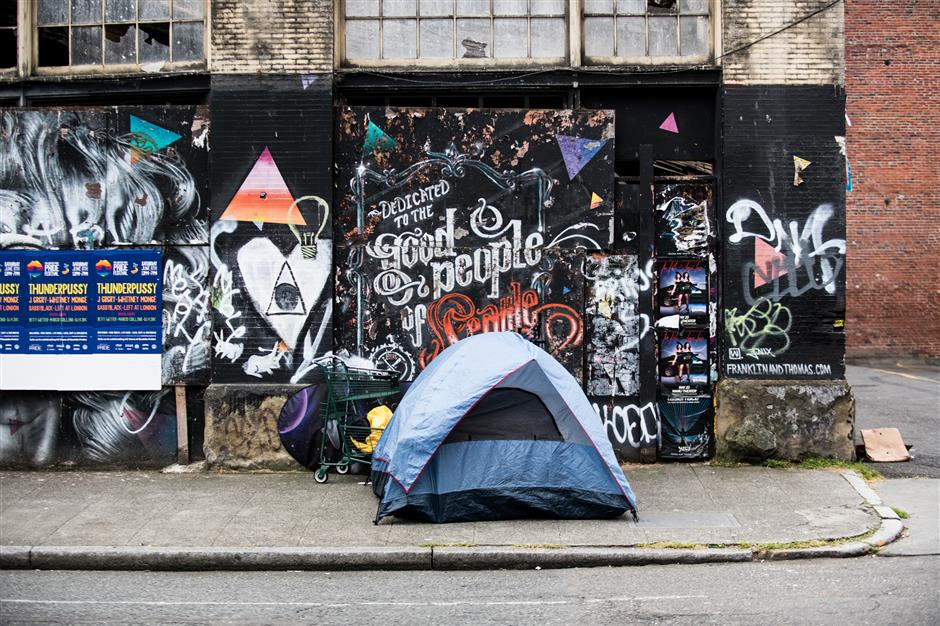 A makeshift tent encampment sits on a street in the Pioneer Square neighborhood of Seattle, Washington, U.S., on Wednesday, June 5, 2019. A year afteru00a0Amazon.com Inc.u00a0and other companiesu00a0beat backu00a0Seattle\'s effort to raise money for homeless services through a tax on large employers, the lobbying win has left the campaign to help one of the countryu2019s biggest homeless populations in limbo, with a patchwork of philanthropic offerings rather than a comprehensive effort to address the issue. Photographer: Chona Kasinger/Bloomberg