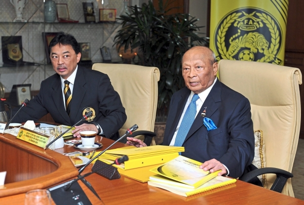 Royal sportsmen: The late Sultan Ahmad Shah, then the president of the Football Association of Malaysia, chairing a meeting at Wisma FAM in 2014 with his son, current King and Ruler of Pahang Al-Sultan Abdullah Ri'ayatuddin Al-Mustafa Billah Shah, who was then FAM deputy president. — Bernama