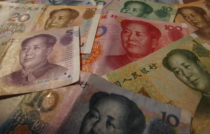 On Saturday, the People\'s Bank of China doubled the yuan\'s daily trading range, so that it can now rise or fall 2% from the daily midpoint rate, although in early deals it held with the previous band of +/- 1% - Reuters Photo.