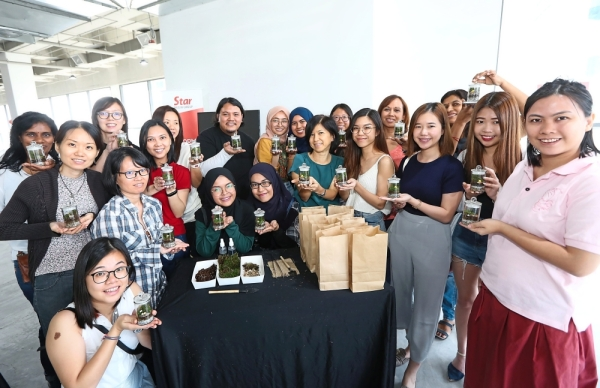 The Terrarium Project founder Faisal Hashim (centre) and participants of his workshop proudly showing off the adorable terrariums they made after an hour's class at the Star WOW Fiesta 2019.