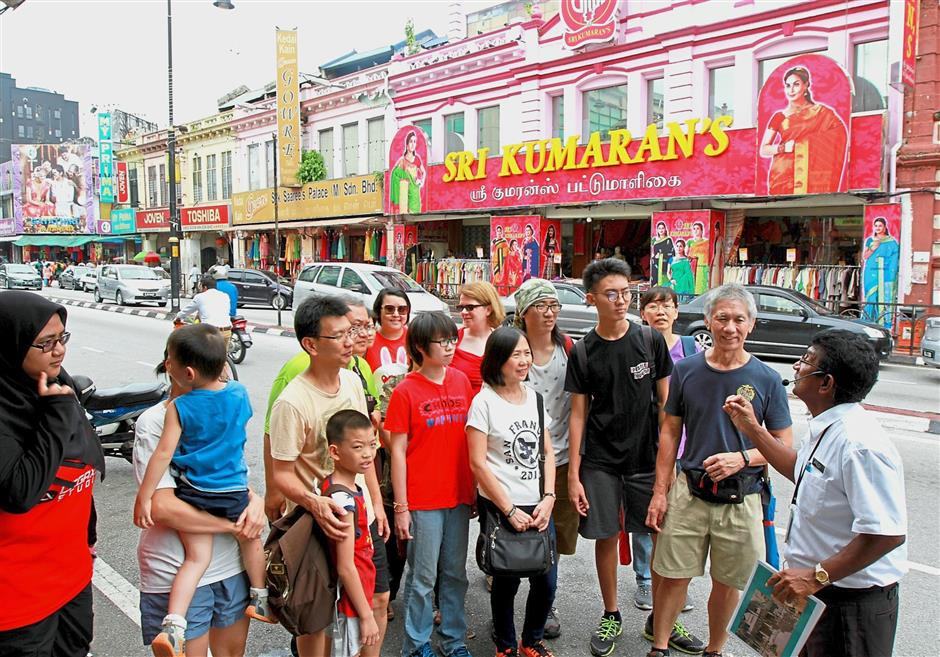 Freelance tour guide Alex Raj hired by Tourism Selangor giving an insight into the history of the colourful Little India along Jalan Tengku Kelana, in south Klang. — filepic