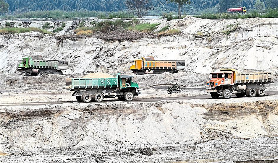 Lorries were seen carrying out sand from the mining pool.