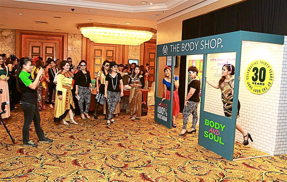 Photo op outside the hotel ballroom for guests attending The Body Shop Malaysia's 30th anniversary celebration in Kuala Lumpur. 11 June 2014 CHAN TAK KONG/The Star