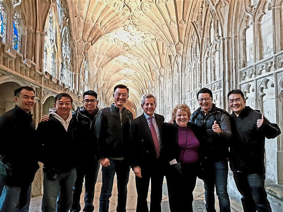 Meeting of minds: Malaysian entrepreneurs met with UK Prime Minister's Trade Envoy to Malaysia, Richard Graham (fifth from left) while visiting Gloucester Cathedral.