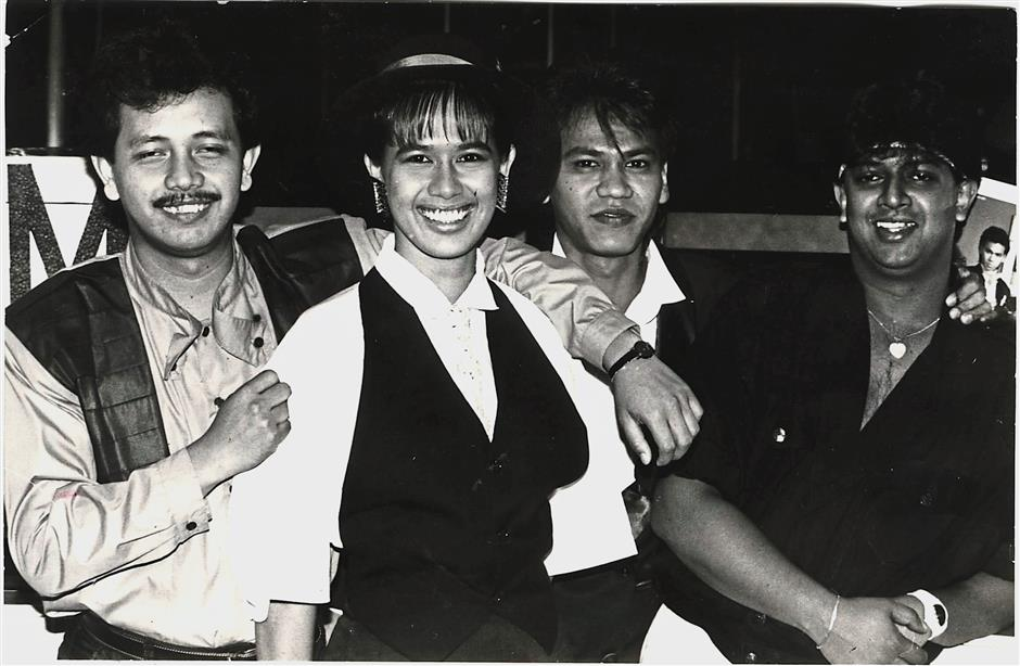 A 1988 photograph of Shuaib (left) and Seha with the other members of Freedom.