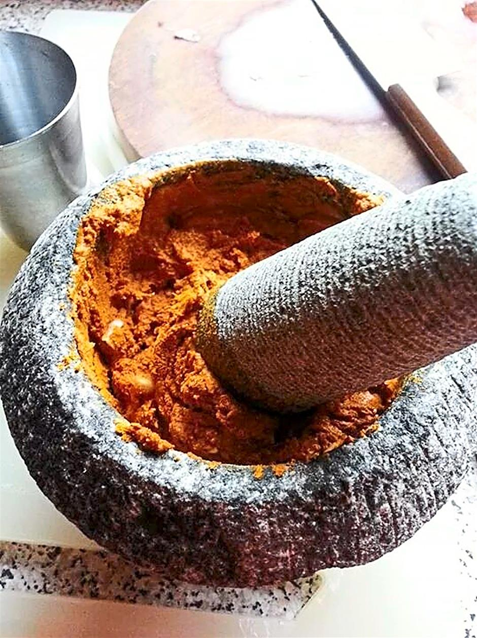 Thanks to her work, Americans are getting acquainted with things like sambal belacan.