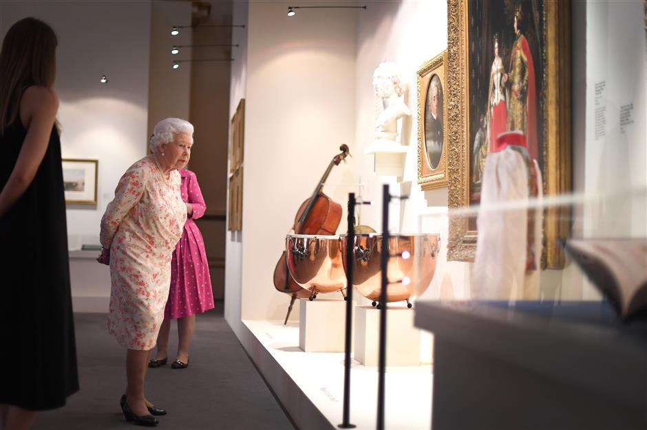 REFILE - ADDING BYLINE  Britain's Queen Elizabeth II attends a special exhibition celebrating the 200th anniversary of the birth of Queen Victoria which marks this year's Summer Opening of Buckingham Palace in London, Britain, July 17, 2019. Victoria Jones/Pool via REUTERS