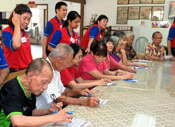 Senior citizens focusing on their Bingo game.