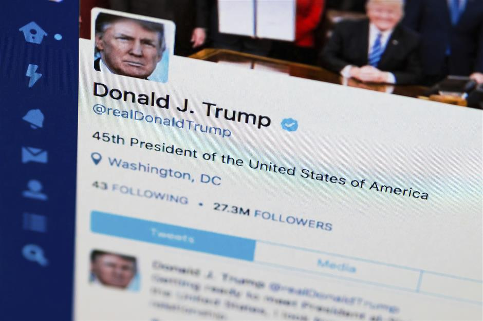 FILE - This April 3, 2017, file photo shows U.S. President Donald Trump\'s Twitter feed on a computer screen in Washington.  President Donald Trump violates the U.S. Constitution\'s First Amendment when he blocks critics on Twitter for political speech, a judge ruled Wednesday, May 23, 2018. (AP Photo/J. David Ake, File)
