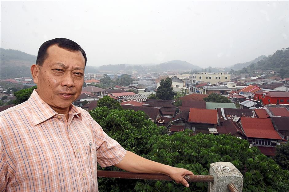 Former Negeri Sembilan state assemblyman Datuk Siow Chen Pin is proud of his hometown. Pictured here is Siow with the quaint town of Titi in the background.