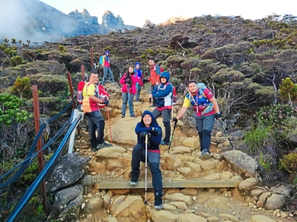Mohd Khairuddin (front) during a recent hike up Mount Kinabalu, which he considers a personal achievement.