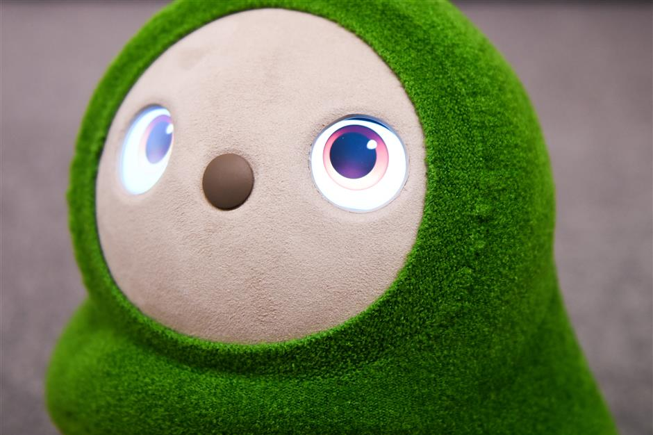 A Groove X Inc. Lovot Edamame home robot stands at the company\'s office in Tokyo, Japan, on Tuesday, Dec. 11, 2018. The Lovot is meant to live at home, where itu2019s only job is to roam around the house, beg you for hugs and generally act as an adorable pet that helps you unwind after a long day. Itu2019s the brain child of Kaname Hayashi, a former Formula One race-car designer and developer who worked on Pepper,u00a0Masayoshi Sonu2019s attempt at creating humanoid assistants. Photographer: Noriko Hayashi/Bloomberg