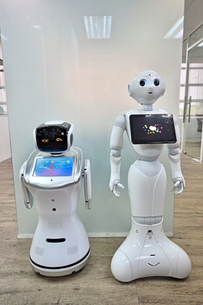 Sanbot (left) and Pepper, two of the robots that come in handy for businesses.