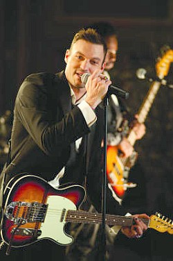 The married Brian Austin Green plays a bachelor, Tommy, in Wedding Band.