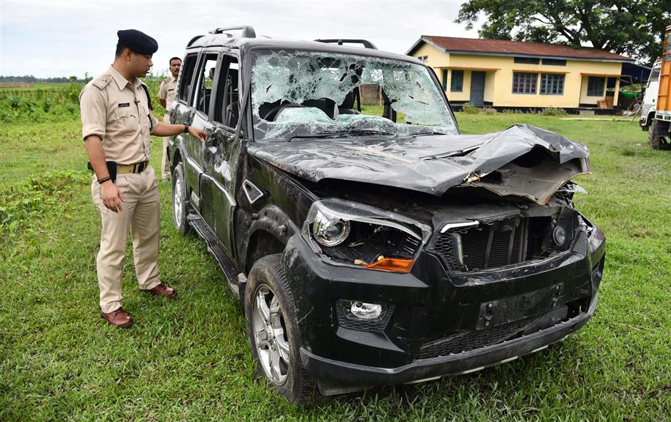 This photo taken on July 10, 2018 shows Gulshan Daolagupu, deputy superintendent of police, showing the damaged vehicle in which two men were lynched at Dokmoka Police station in Karbi Anglong district, some 180km from Guwahati, the capital city of Indiau2019s northeastern state of Assam. The smartphone footage shows the two blood-soaked men pleading for their lives. Moments later they were dead, two more victims of lynchings sparked by rumours spread on Facebook and WhatsApp in India. Abhijeet Nath and Nilotpal Das were beaten to death by a mob in Karbi Anglong district that suspected the youths to be child abductors on June 8.  / AFP PHOTO / Biju BORO / TO GO WITH INDIA-TECHNOLOGY-MEDIA-INTERNET,FOCUS by Alexandre MARCHAND