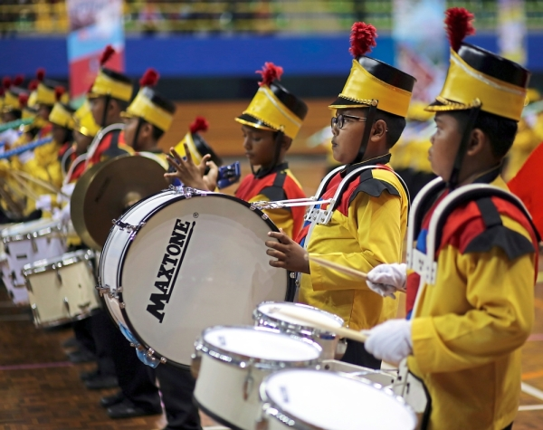 Marching band members of SK Bandar Puteri Jaya, Sungai Petani, performing during the final of the primary school category of the national competition, winning the team the Best Conductor prize.
