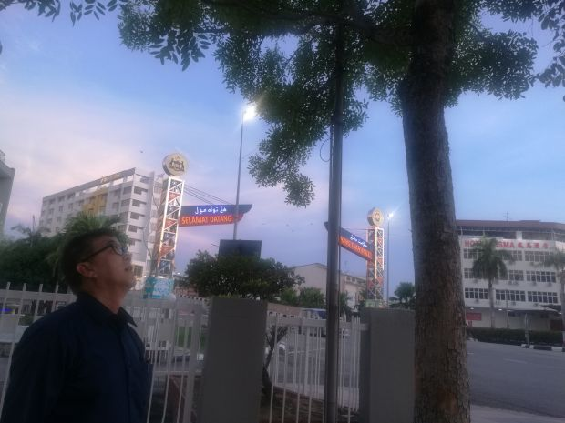 LOOKING FOR THIEVES..MBMB councillor Tan Chin Gwan looks for panty stealing crows in Melaka. Pix by R.S.N.Murali