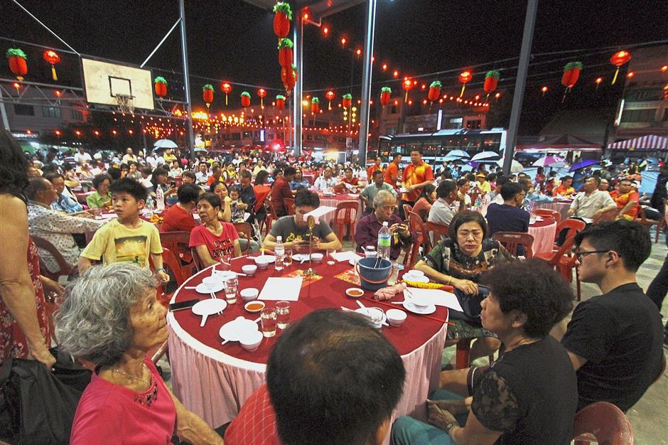 Thousands of people dining together during the Chinese New Year carnival.