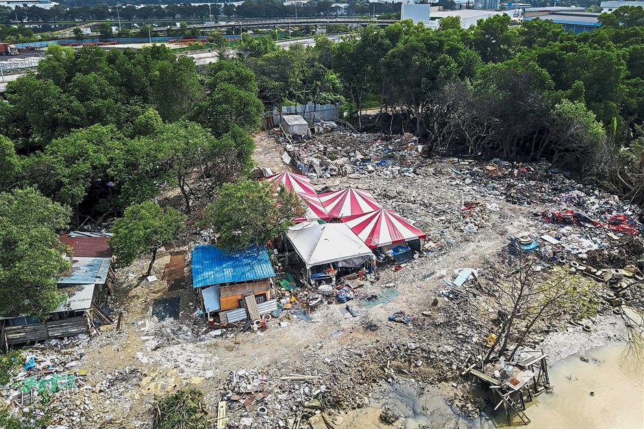 No more in operation: An aerial view of an illegal dumpsite beside the Prai River in Seberang Jaya.