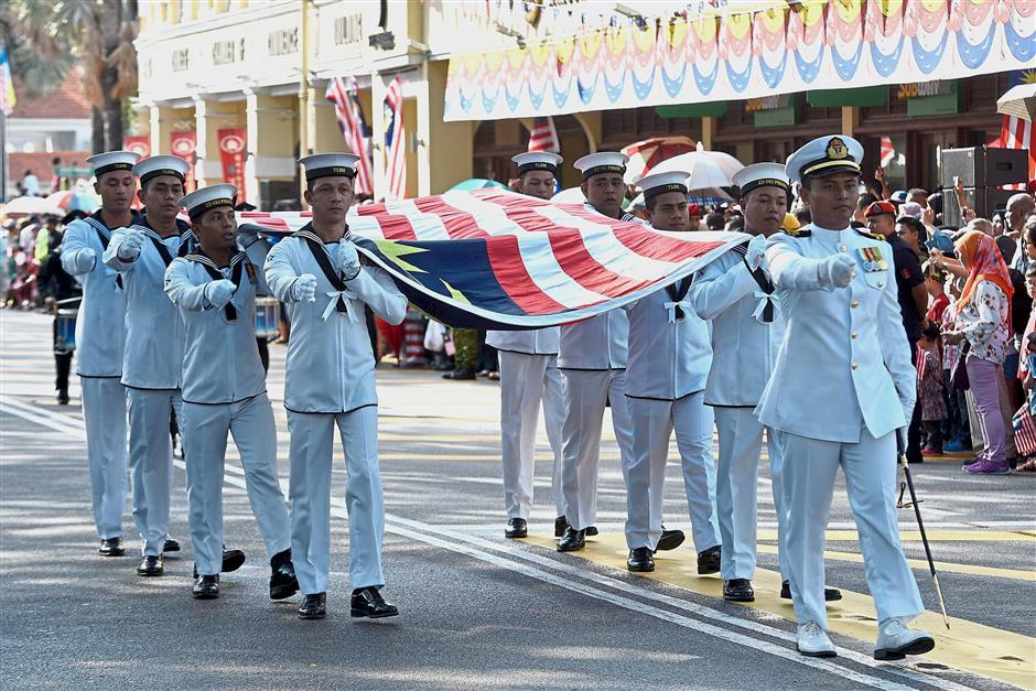 The Royal Malaysian Navy contingent marching along the street.