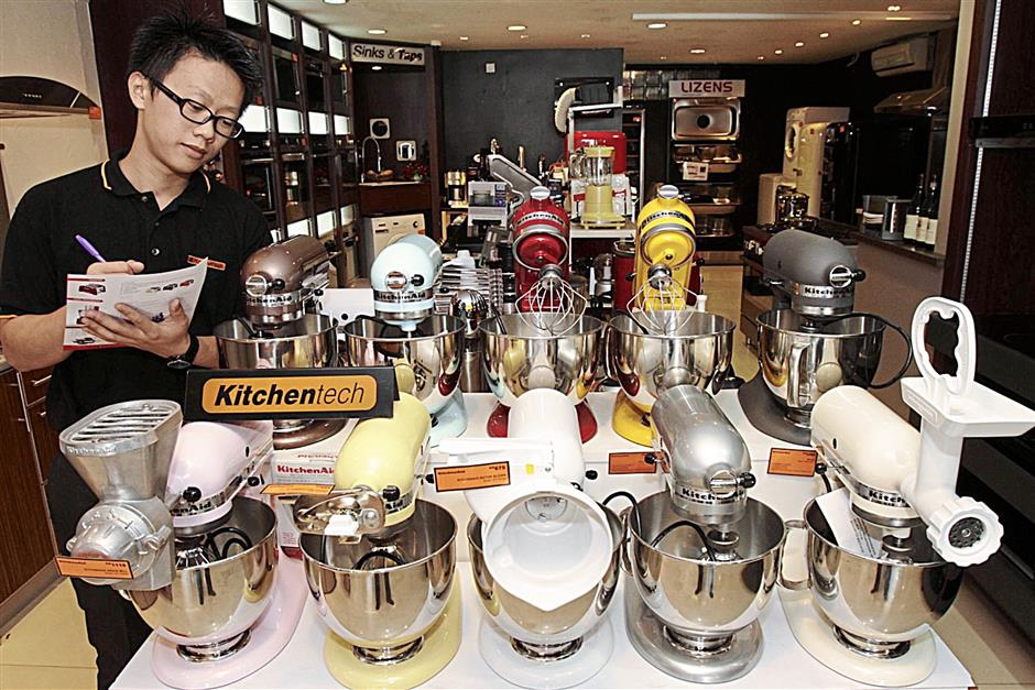 Kitchen appliances on display at the Ban Hin Bee store in Penang. The company says consumers are spending more cautiously these days.