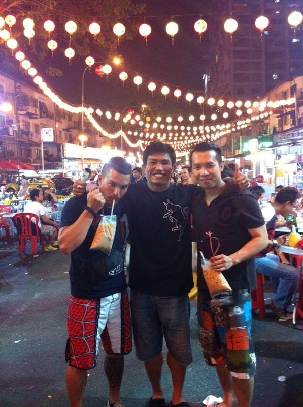 Muay Thai practitioner, Bunyarit Charoenrit (centre) and his friends enjoy food excursions as well