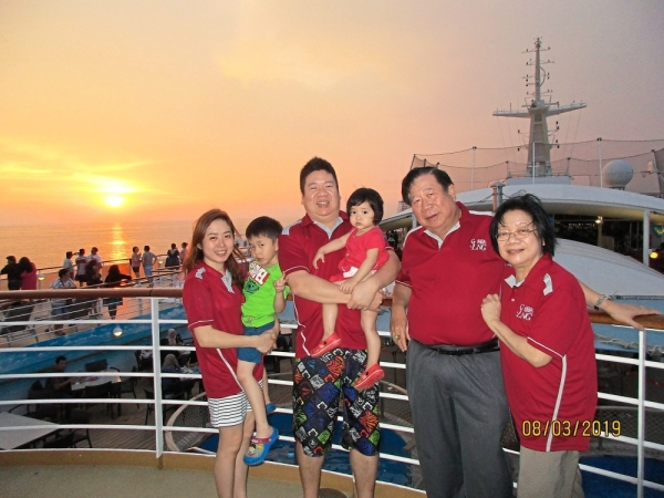 Ng (second from right) with his family on a holiday cruise.