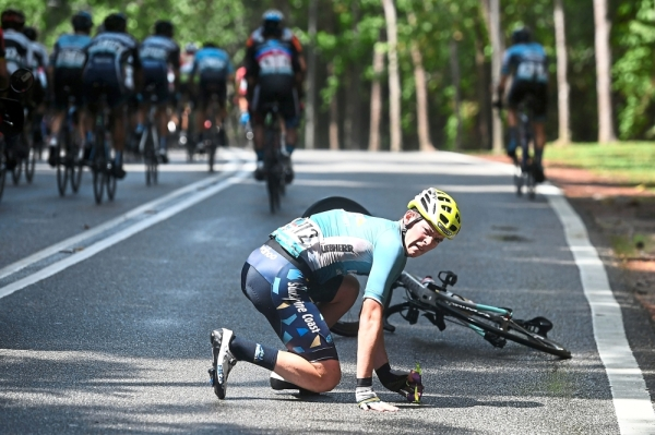 Oops!: Pro Racing Sunshine Coast's Michael Potter of Australia tries to get up after a fall during the stage. — AFP