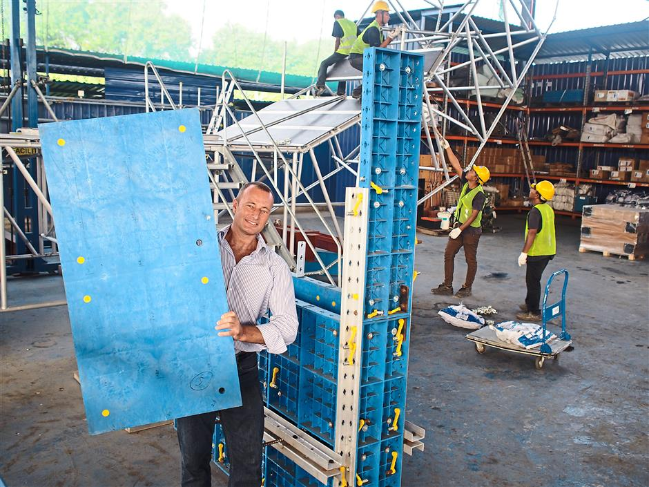 Innovation: Descaff Group director Chris Hillierlifting one of the companys innovation, the sustainable building solutions (SBS) formwork system using recyclable plastics and reinforced with steel instead of the conventional wood-based formwork that is not environment-friendly.