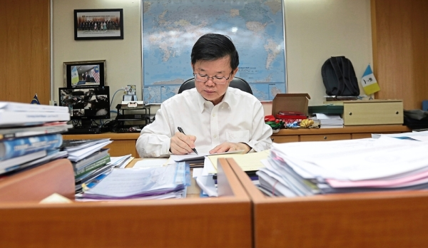 Chow going through some documents at his office in Komtar. — Photos: ZHAFARAN NASIB/The Star