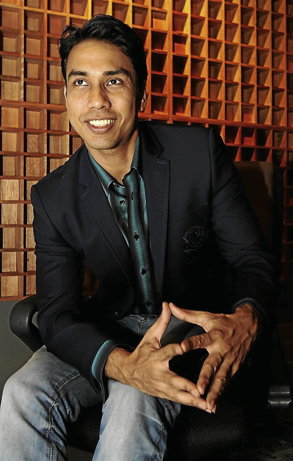 All smiles: Television host, emcee and model Raj Aria is confident when he's wearing Bon Zainal.