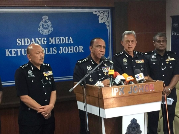 Johor police chief Comm Datuk Mohd Khalil Kader Mohd (second from left) giving a press conference at the Johor Baru police headquarters here on Monday (June 17)