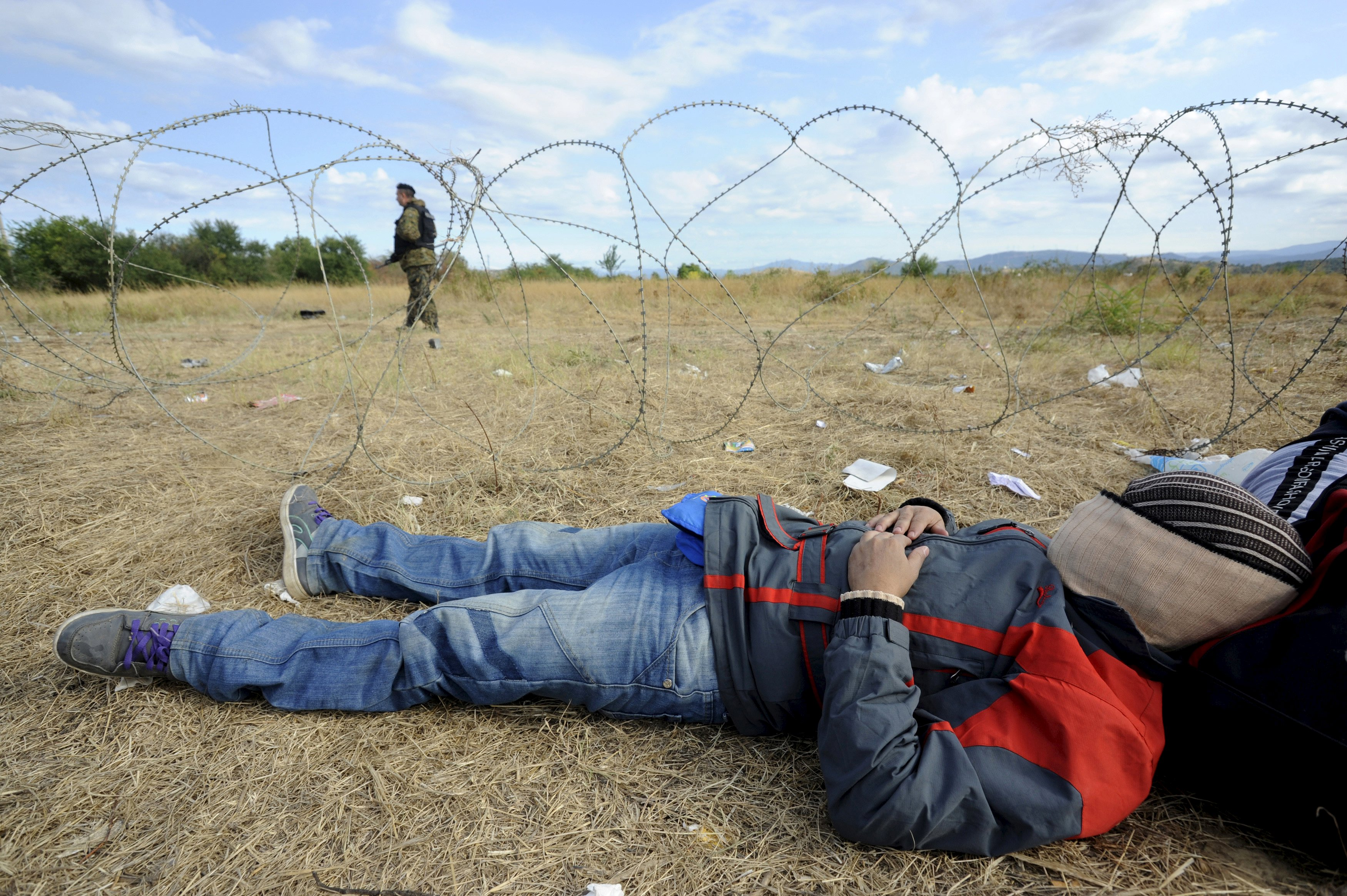 With tear gas and razor wire, Macedonia tries to stem