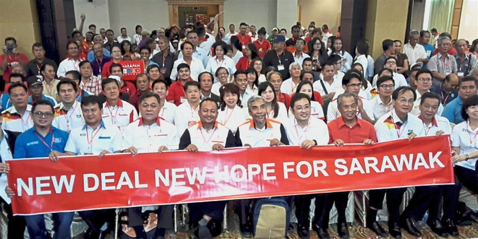 Standing united: Muhyiddin (third from right) attending the state Pakatan Harapan convention in Sibu.
