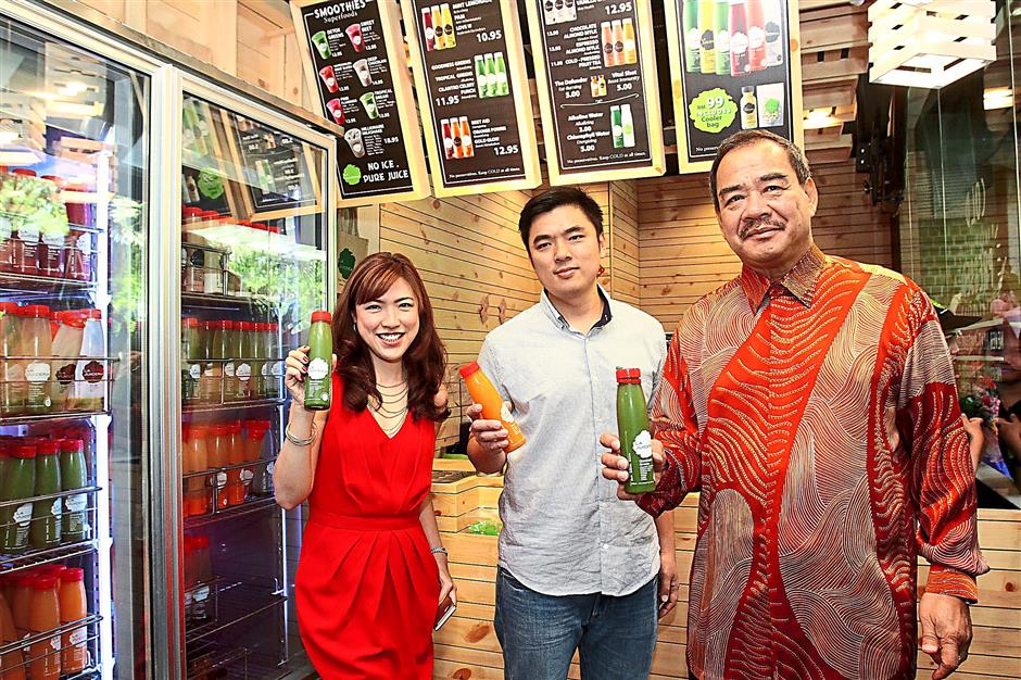 Towards a healthy lifestyle: (from right) Kong, Hong and Co-Martinent at the opening of La Juiceria's latest outlet.