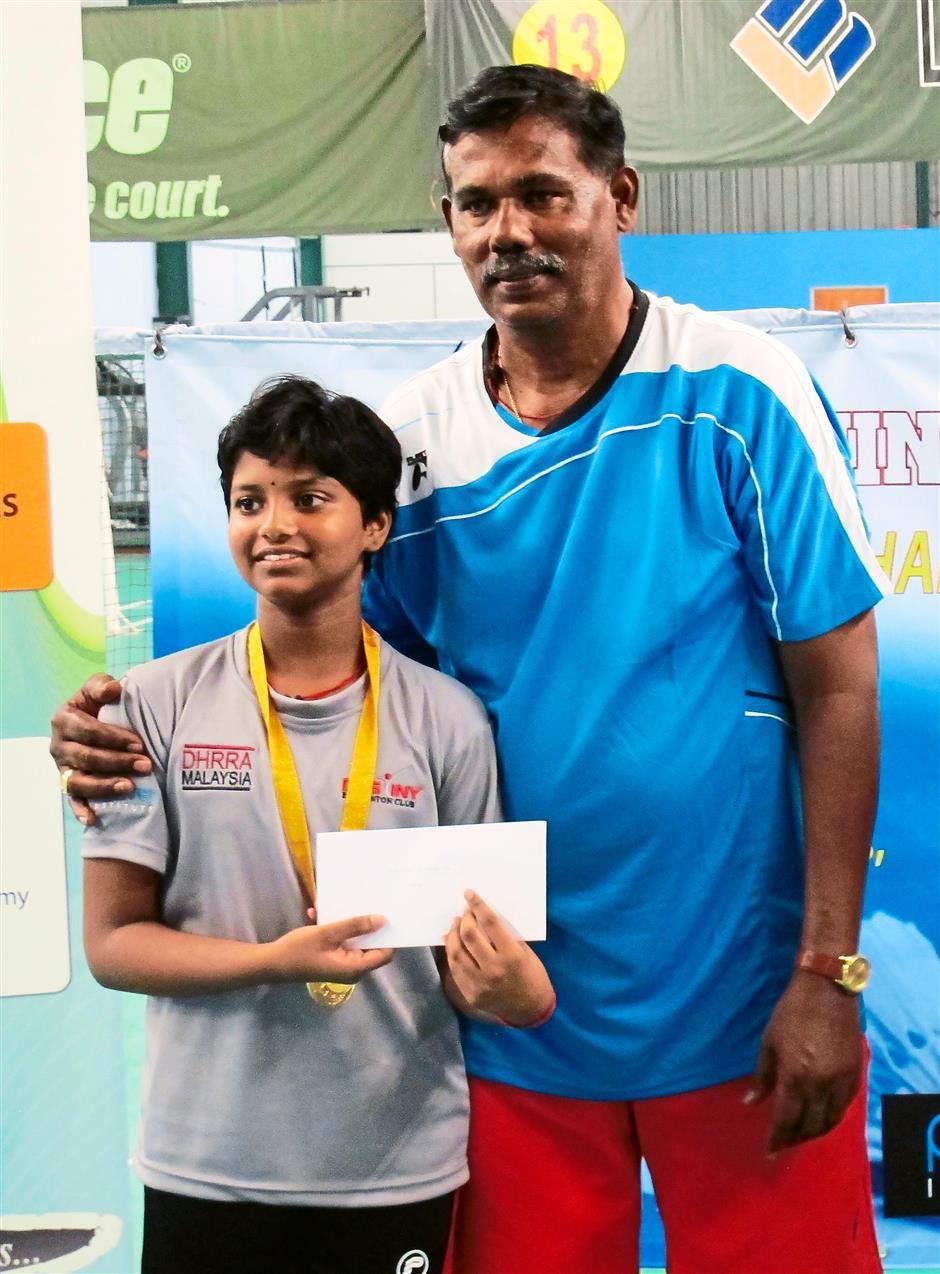 Future star: Bavatharani (left) with coach M. Arikrishnan.