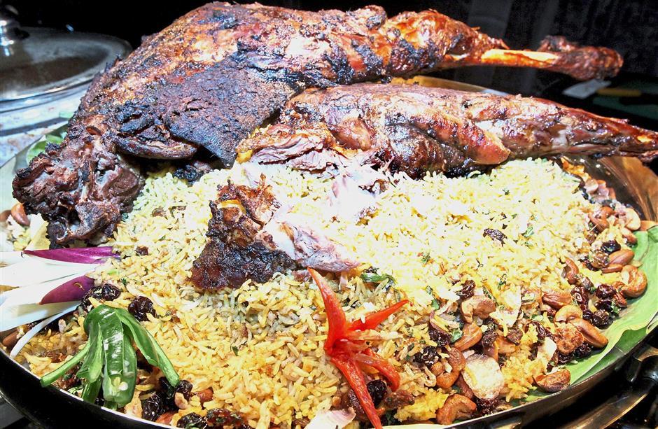 Pit-roasted Thai-style kibas with Arabic briyani rice.