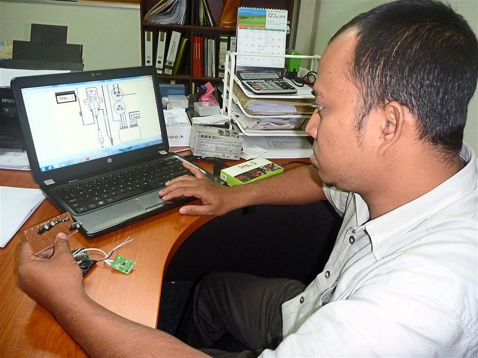 One of the company's technicians analysing a circuit diagram.