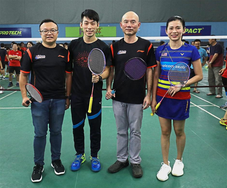 Lim (second from right) paired with Goh in an opening gimmick. They wentagainst Yew (far left) and Chan.