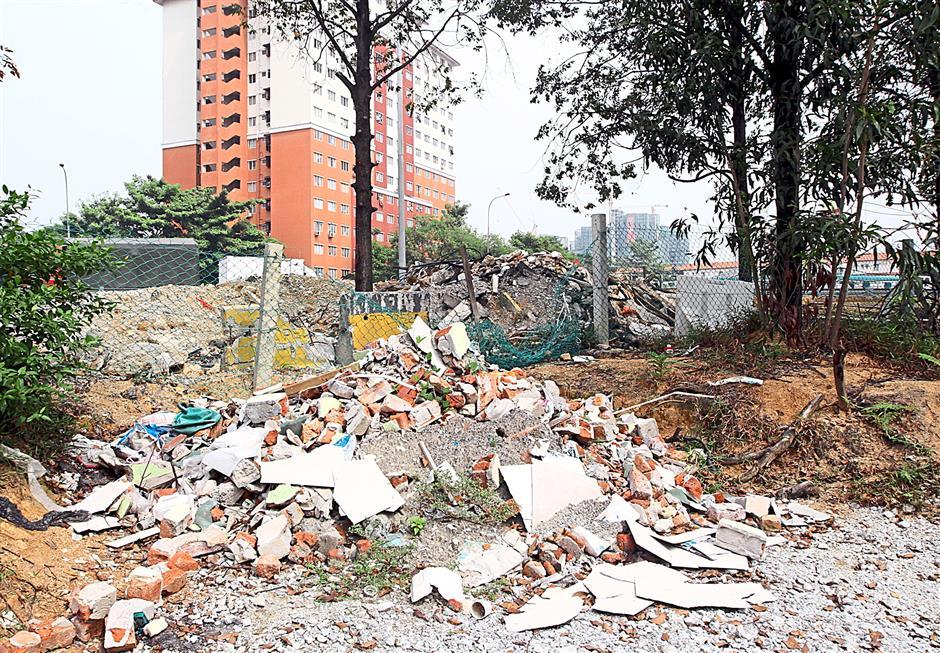 Heaps of illegally dumped construction waste at Jalan Bukit Mayang Emas.