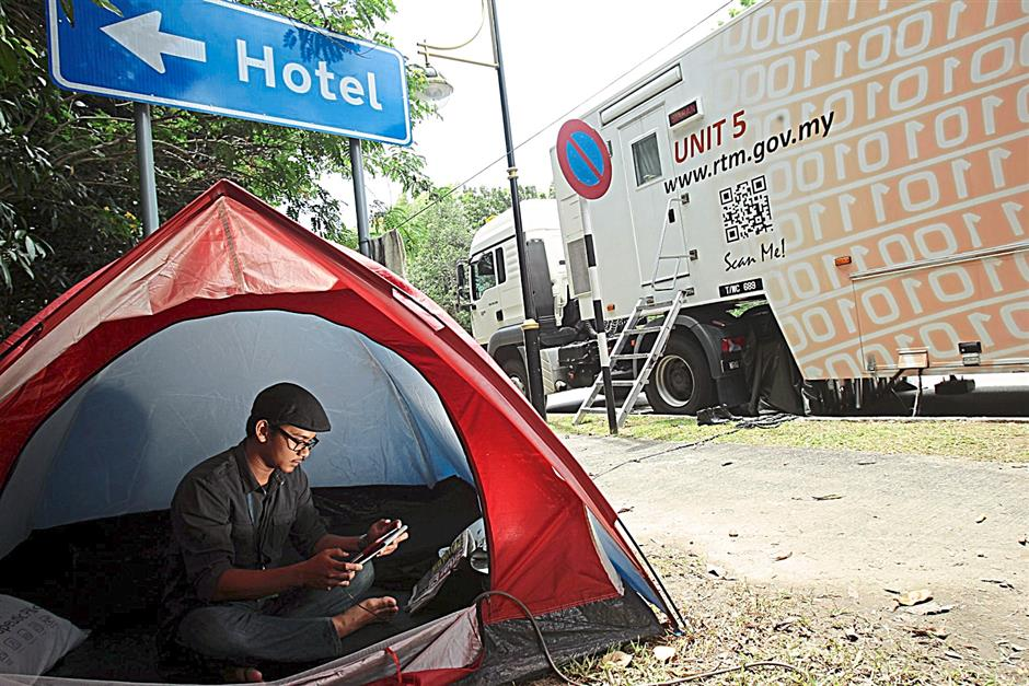 RTM's assistant engineer, Mohammad Adzim Ab Hamid browsing internet during his break after covering missing MAS flight MH370 at Sama Sama Hotel yesterday.AZMAN GHANI / The Star