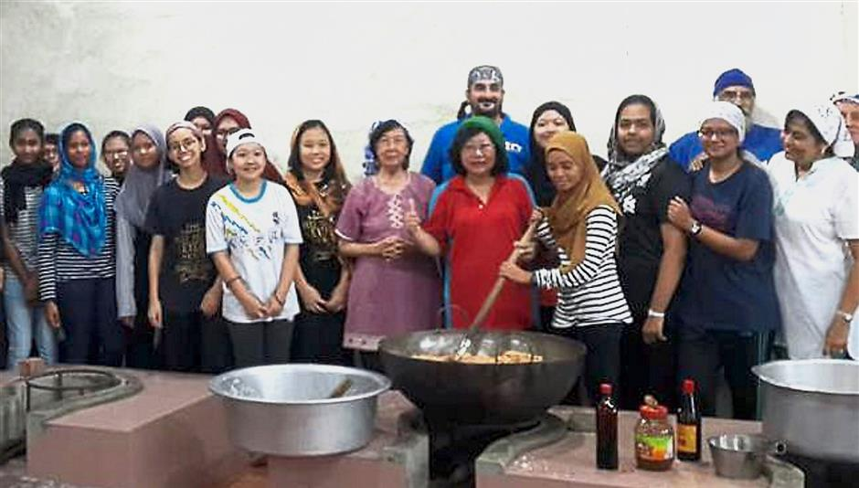 A group of volunteers from the Gurdwara Sahib Taiping soup kitchen during a recent event to feed underprivileged people.